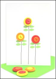 Handmade Blank Greeting card embellished with red, yellow and orange buttons in the shape of poppies