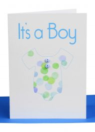Wholesale baby Boy greeting card embellished with a watercolour patterned baby jumpsuit and 2 little blue buttons with the wording 'It's a Boy'.