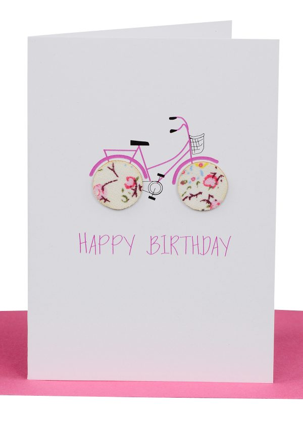 Wholesale Birthday Gift Card embellished with 2 small round wooden paper covered buttons as wheels on a pink bike and and the wording 'Happy Birthday'.